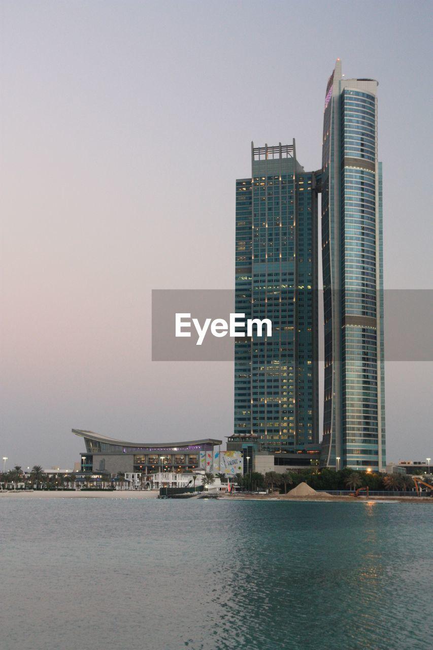 Modern skyscraper at shore