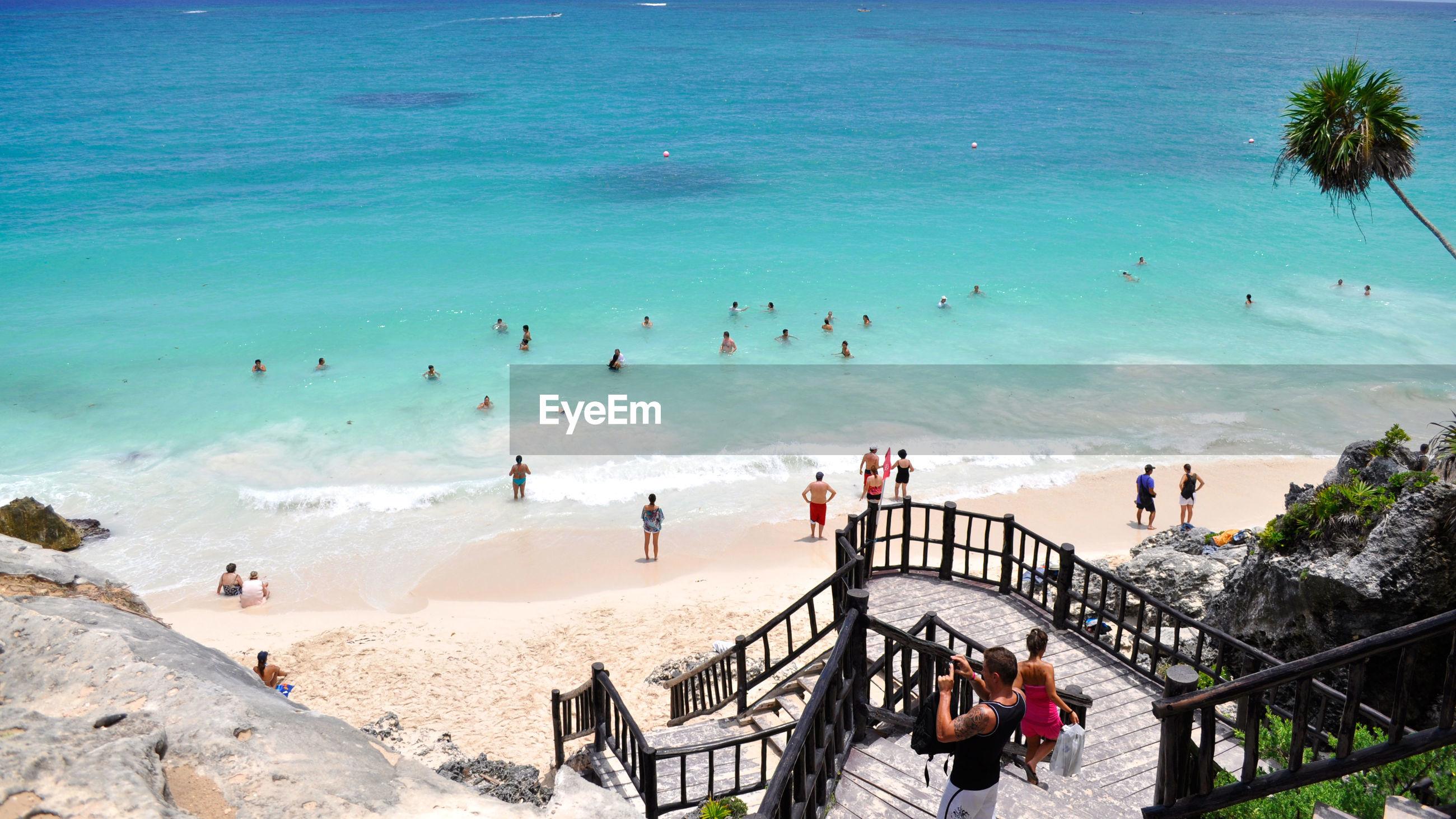 High angle view of people enjoying on beach