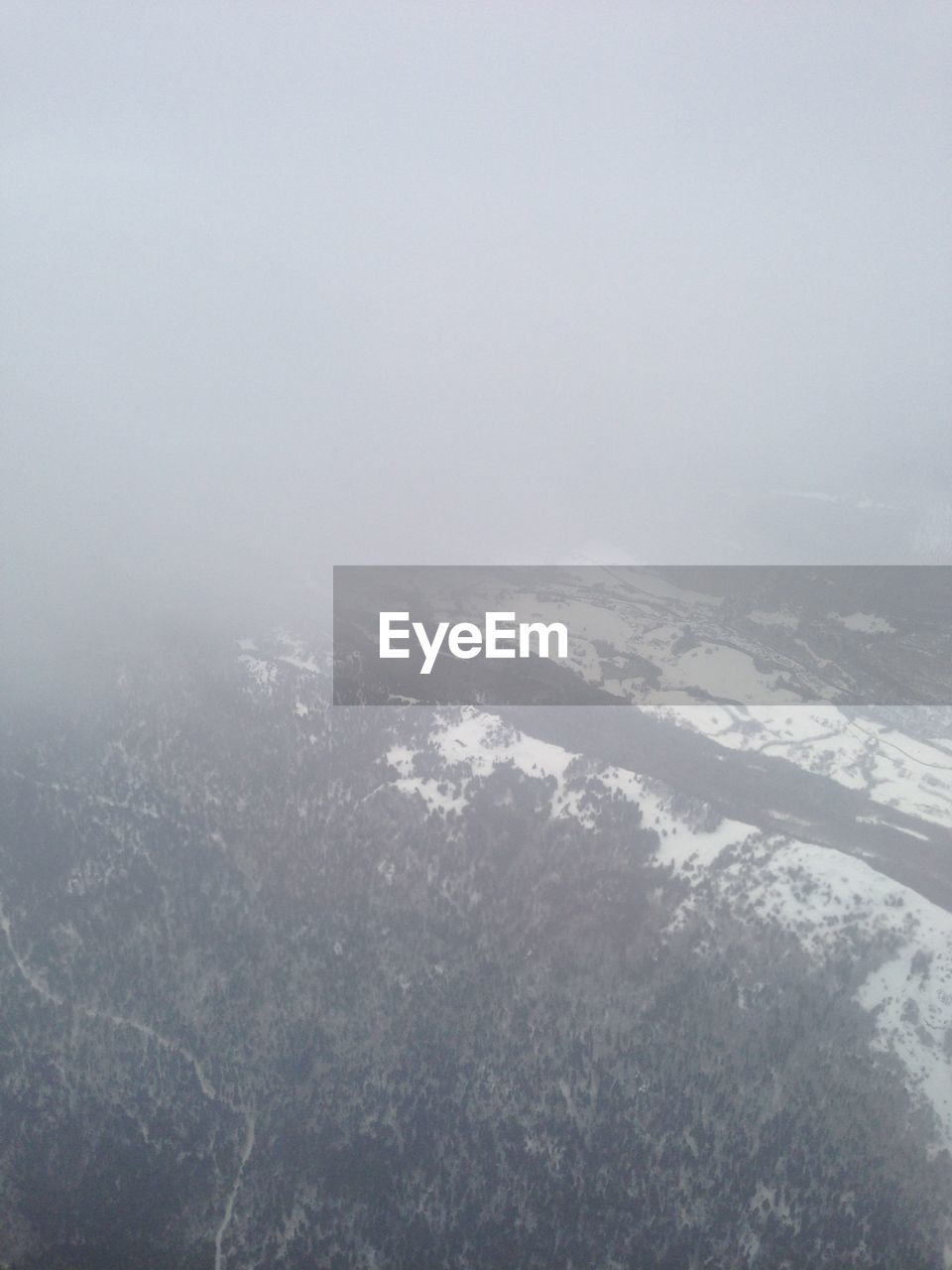 beauty in nature, nature, scenics, landscape, aerial view, cold temperature, winter, tranquility, tranquil scene, no people, weather, outdoors, snow, day, fog, mountain, sky, airplane wing