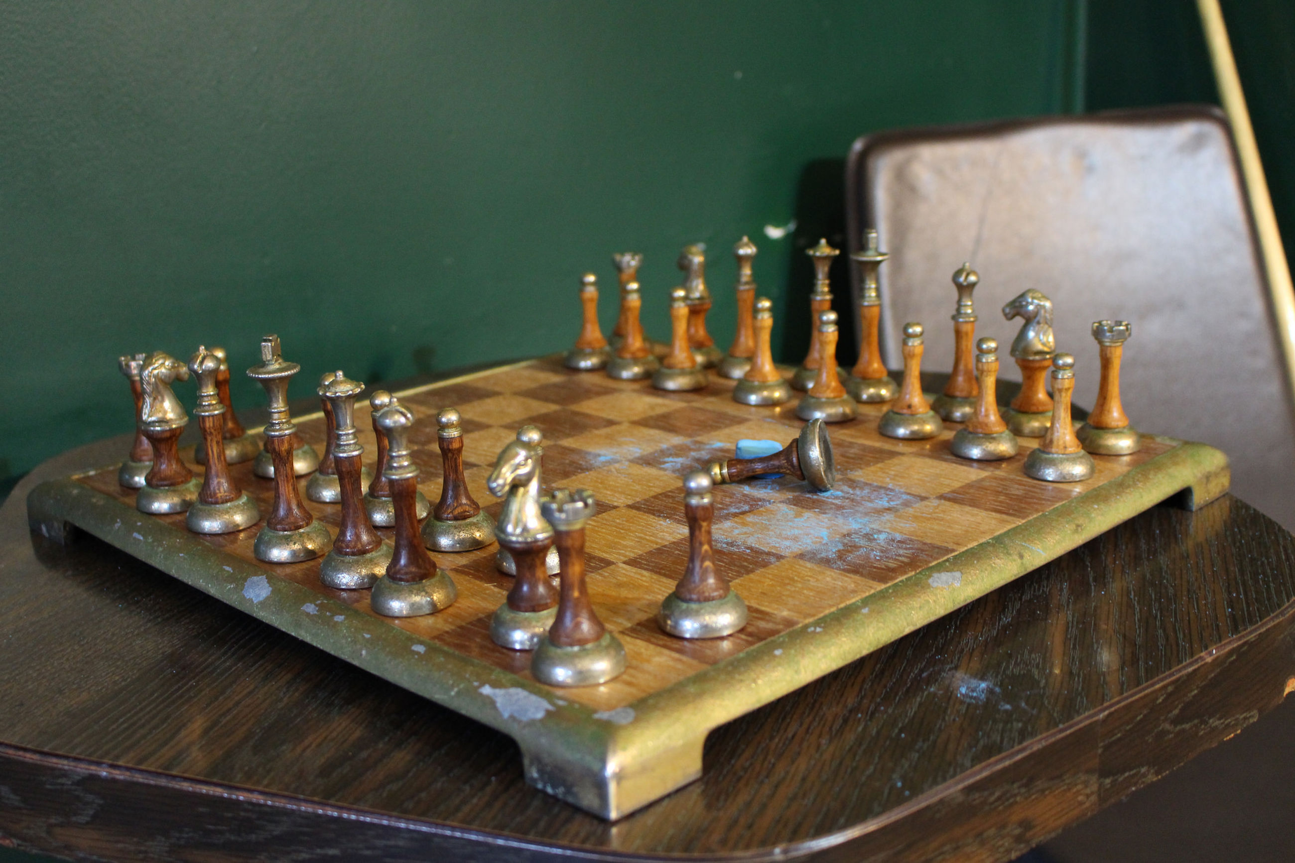High angle view of chess pieces on chess board at home