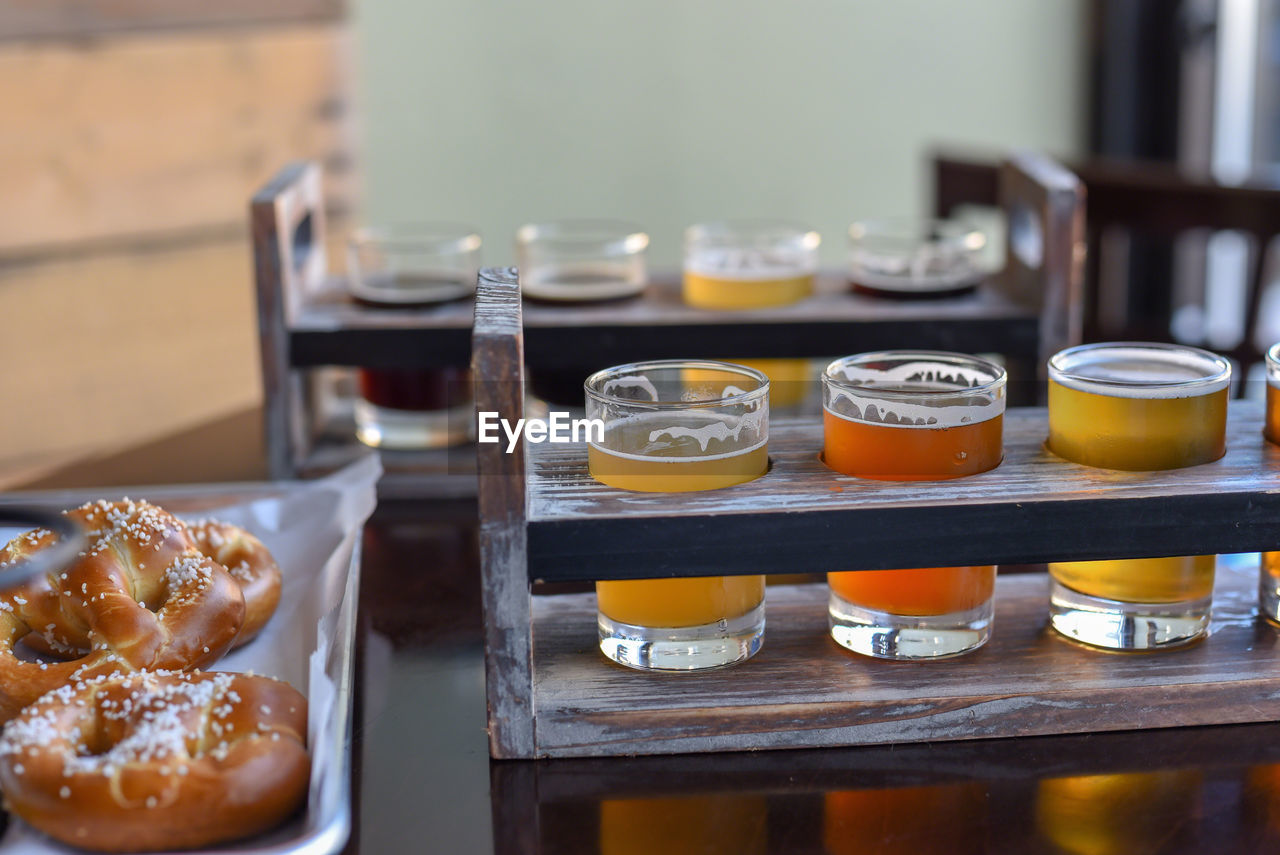 CLOSE-UP OF BEER AND WINE ON TABLE