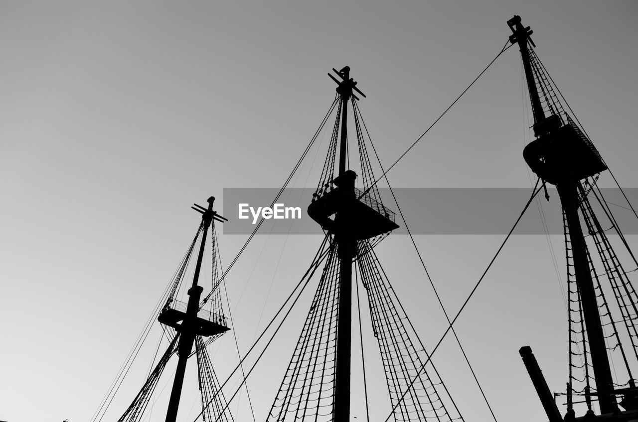 low angle view, sky, outdoors, nautical vessel, mast, day, clear sky, no people, architecture, tall ship