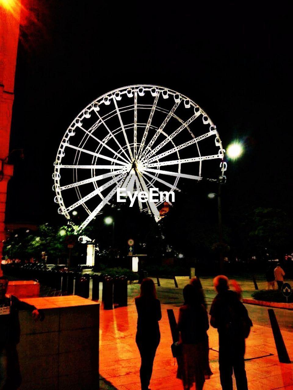 night, illuminated, leisure activity, arts culture and entertainment, amusement park, ferris wheel, real people, lifestyles, women, outdoors, sky