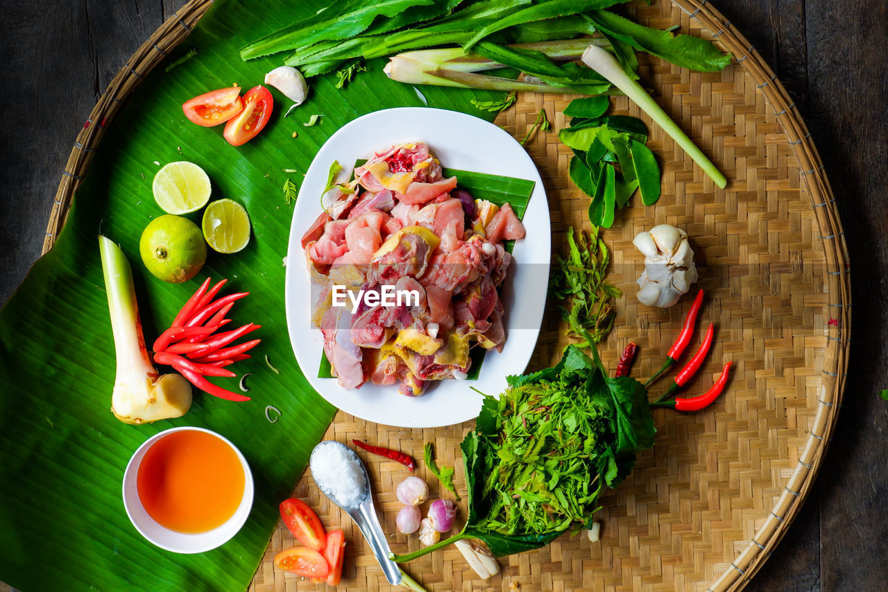 HIGH ANGLE VIEW OF MEAL SERVED IN BOWL ON TABLE