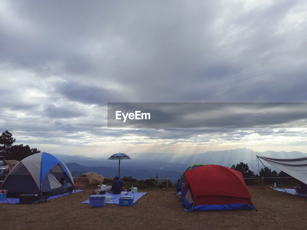cloud - sky, sky, tent, camping, nature, tranquility, no people, outdoors, sea, beauty in nature, day, scenics, nautical vessel, mountain, technology, water, windmill