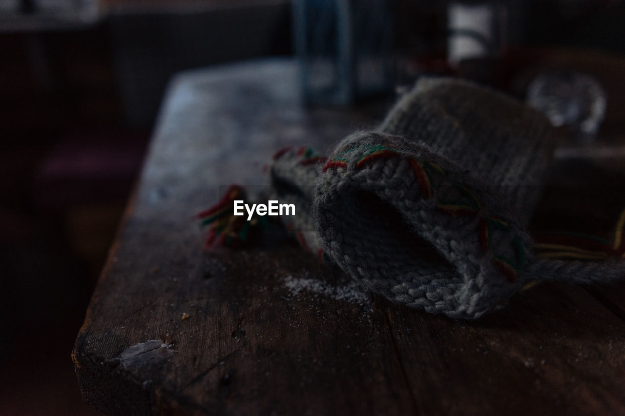 High Angle View Of Knit Hat On Wooden Table