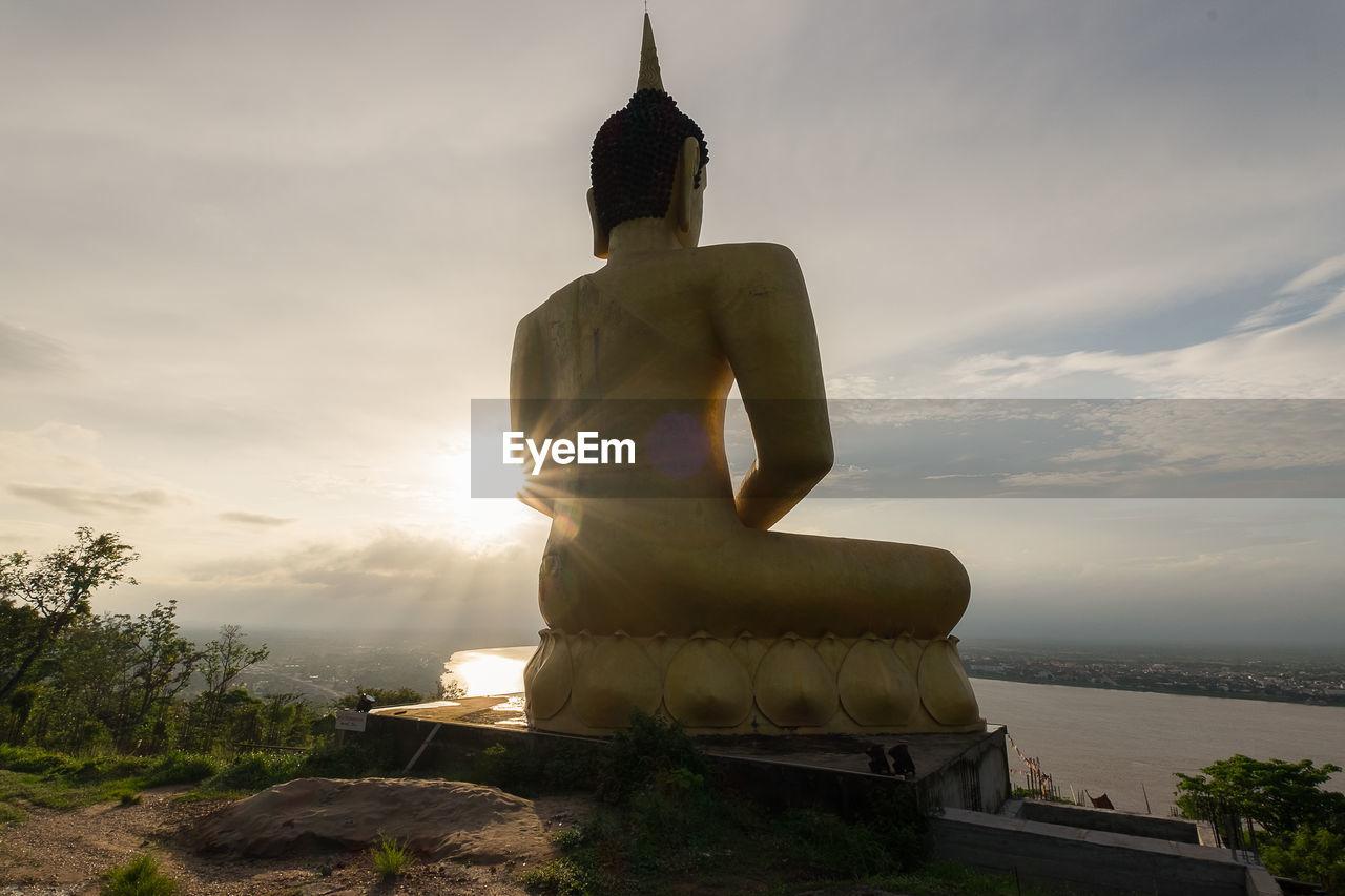 BUDDHA STATUE AGAINST SKY