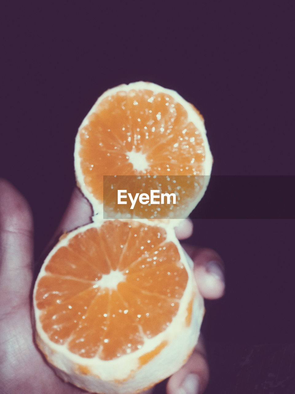human hand, human body part, hand, food and drink, one person, food, holding, freshness, indoors, cross section, unrecognizable person, close-up, studio shot, finger, fruit, healthy eating, wellbeing, human finger, real people, body part, black background, orange