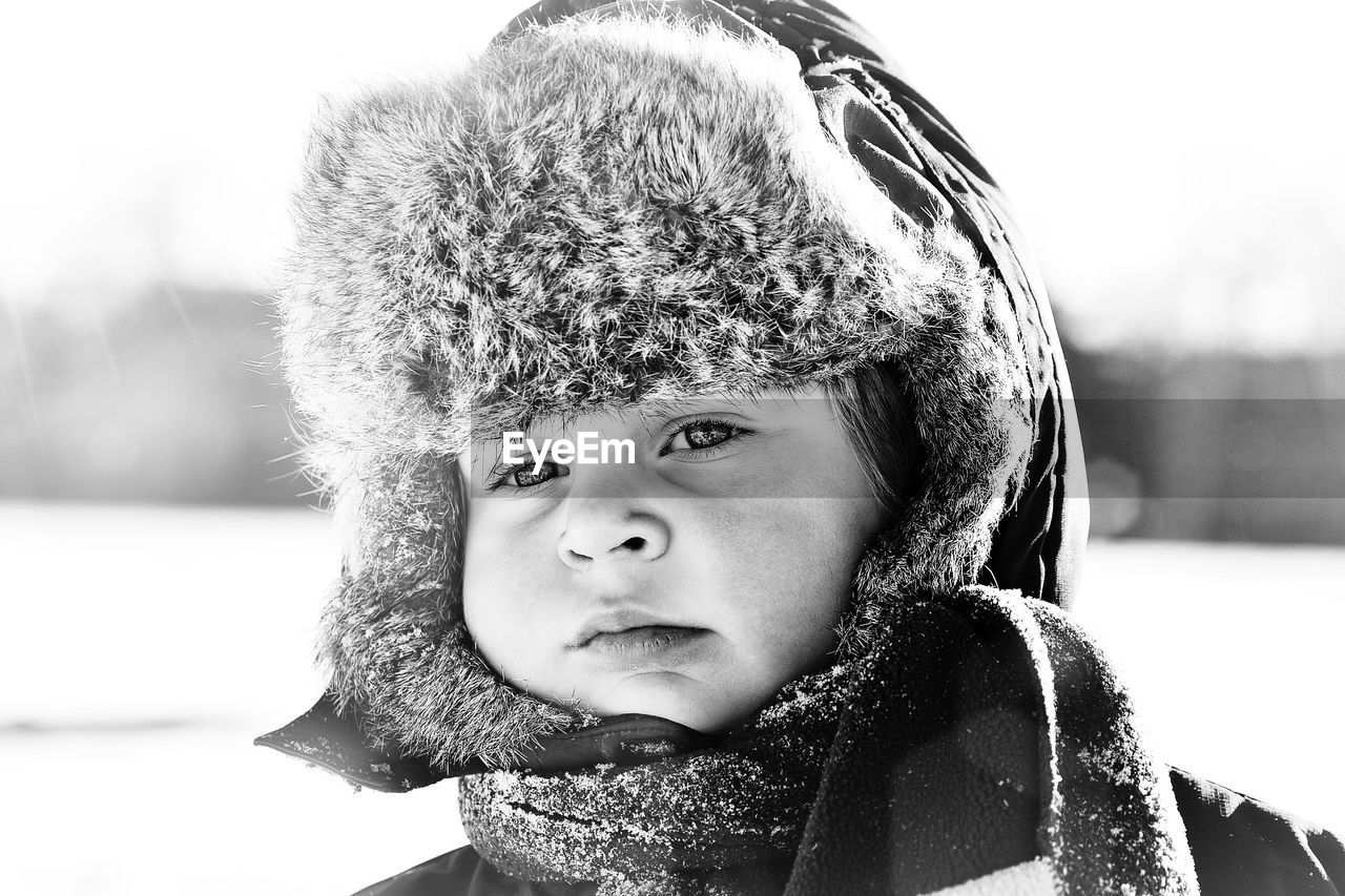 Close-Up Portrait Of Boy In Snow