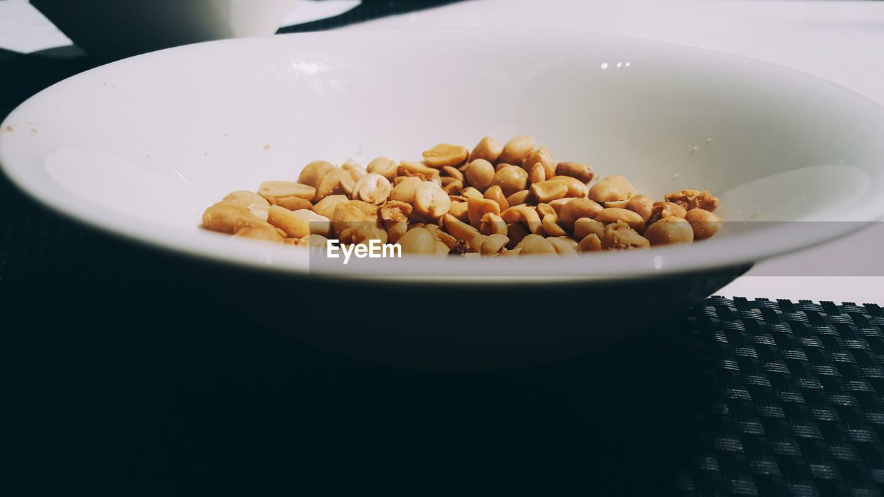 Close-Up Of Peanuts In Bowl On Table