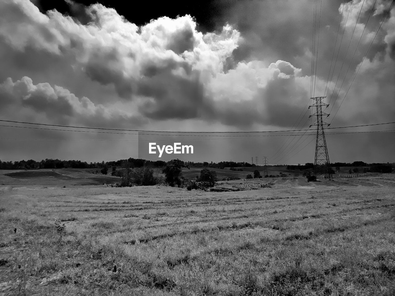 cloud - sky, sky, field, land, landscape, environment, technology, cable, electricity, electricity pylon, no people, connection, nature, scenics - nature, day, fuel and power generation, tranquil scene, grass, power supply, rural scene, electrical equipment