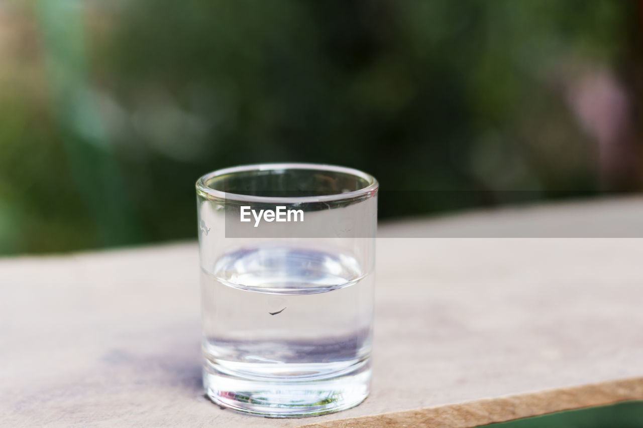 Close-up of drinking water on wooden table