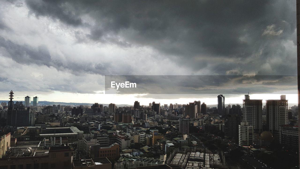 cityscape, building exterior, architecture, city, skyscraper, sky, cloud - sky, no people, built structure, outdoors, modern, day, storm cloud, nature