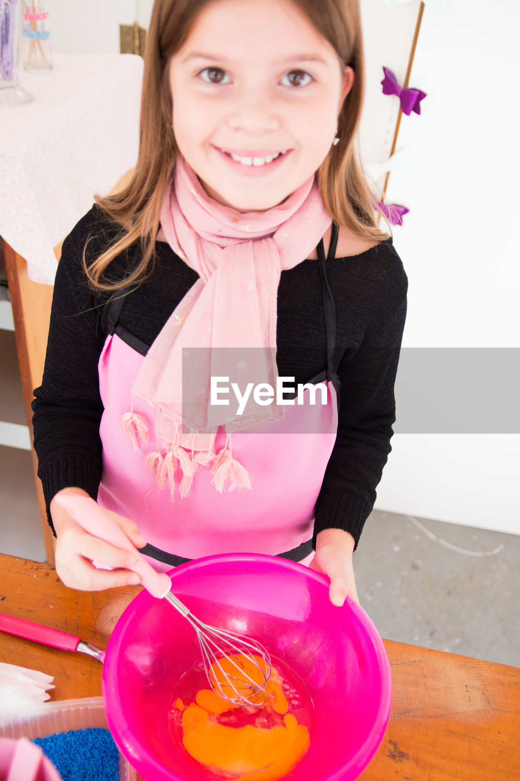 Portrait of smiling girl preparing food at home