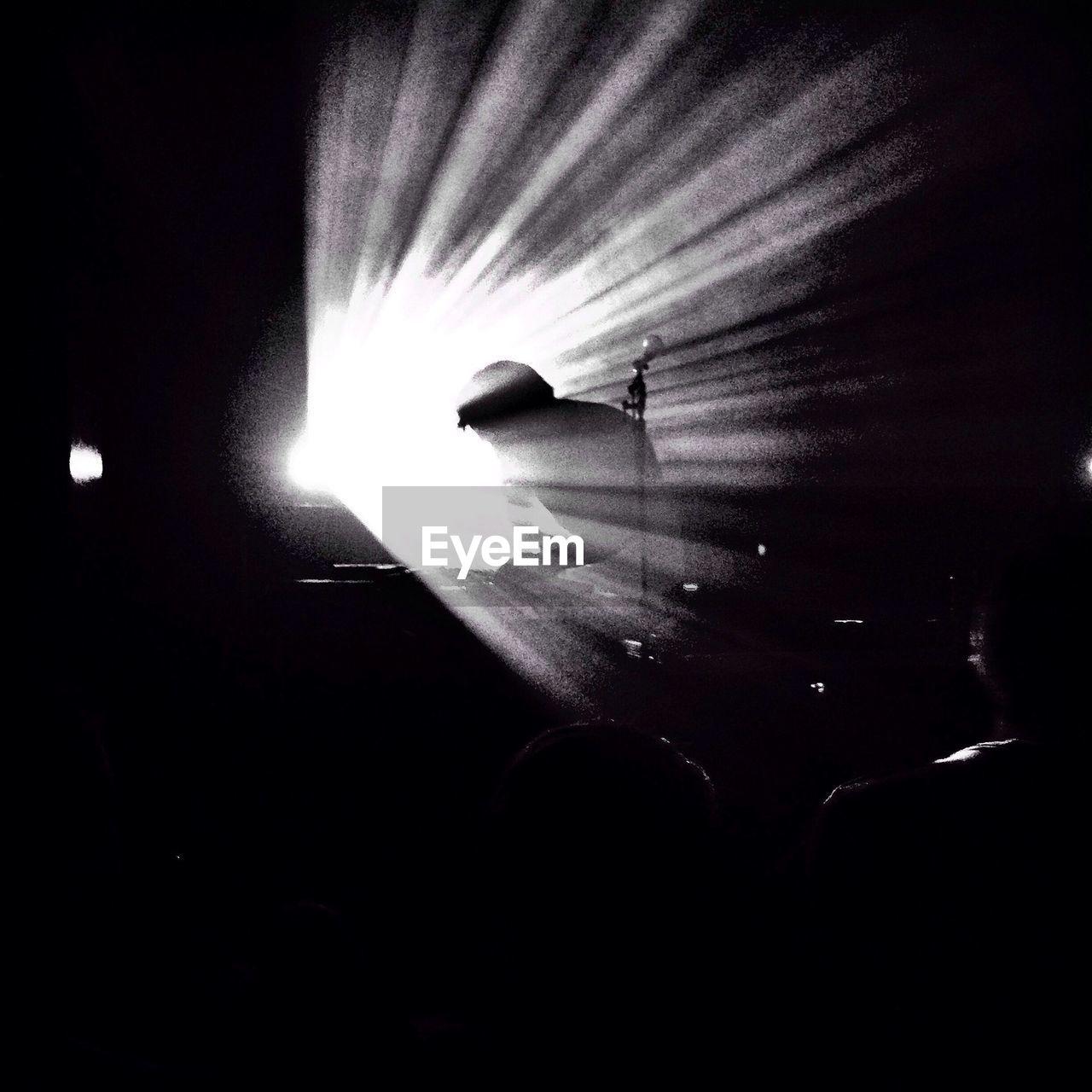 Silhouette dj playing music in nightclub