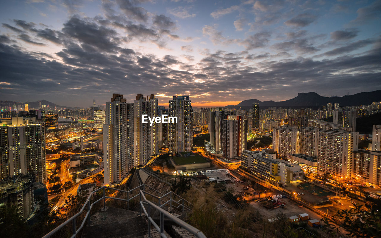sky, architecture, cloud - sky, built structure, city, building exterior, cityscape, nature, sunset, no people, building, office building exterior, skyscraper, residential district, orange color, illuminated, high angle view, outdoors, financial district