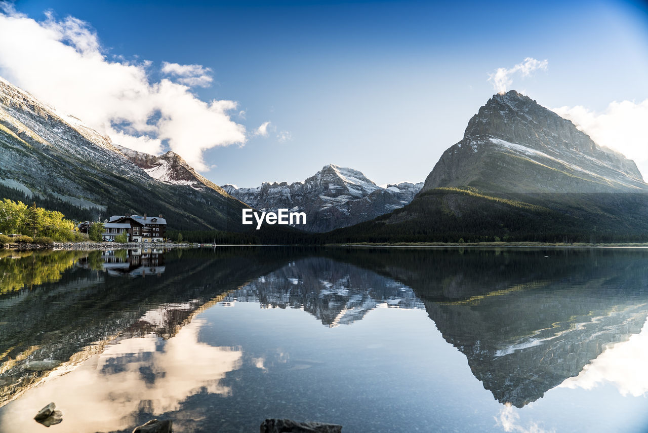 Scenic Reflection Of Mountains In Calm Lake