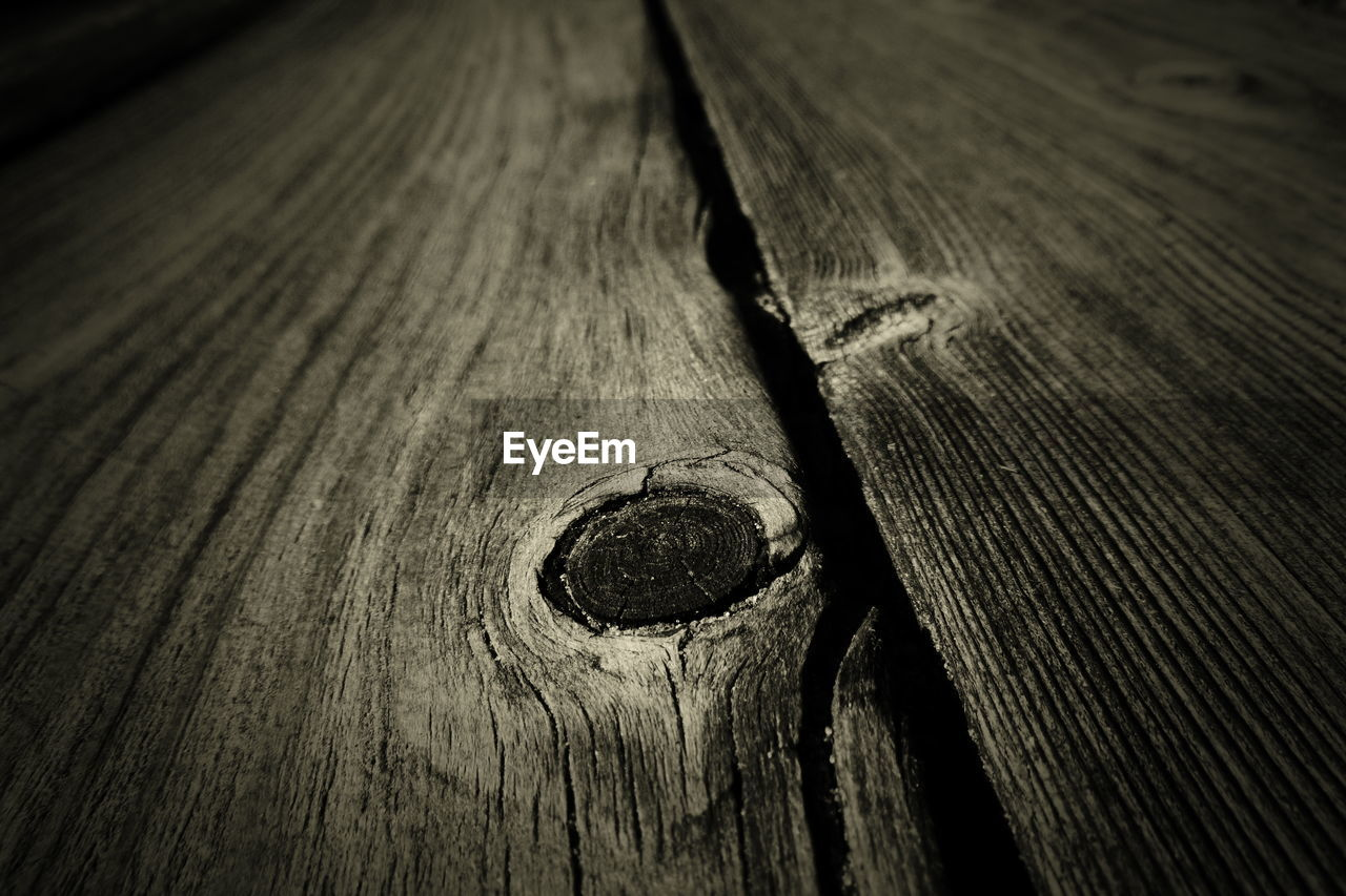 wood - material, close-up, textured, plank, backgrounds, no people, full frame, pattern, wood, rough, selective focus, high angle view, brown, old, screw, day, cracked, outdoors, wood grain, still life, nail
