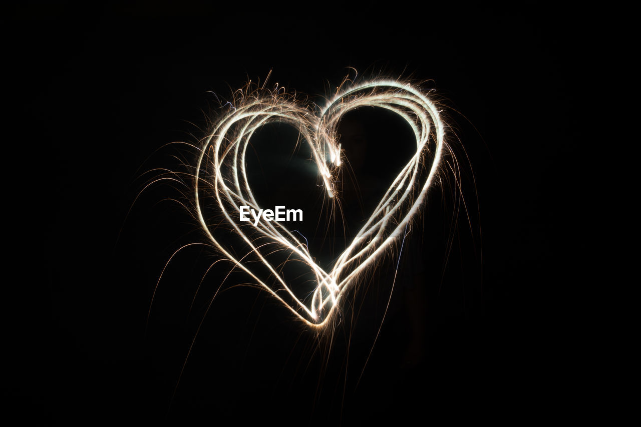 Heart shape made from light painting against black background