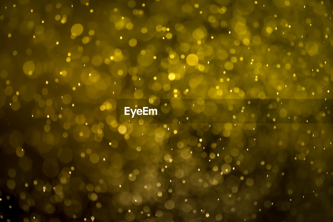 backgrounds, no people, full frame, defocused, drop, wet, water, close-up, nature, outdoors, green color, selective focus, abstract, pattern, illuminated, rain, shiny, freshness, lens flare, raindrop, purity, dew