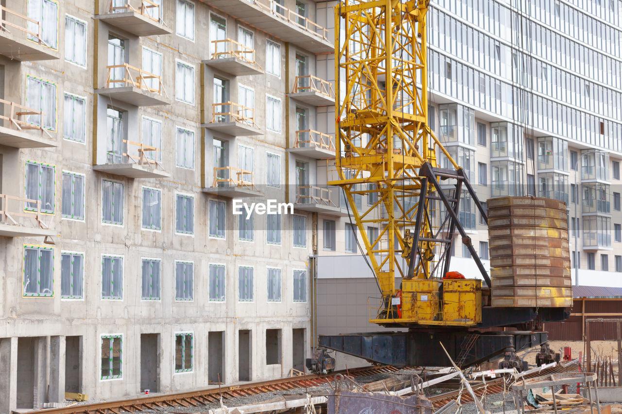 Construction site and crane building a skyscraper. modern technologies.