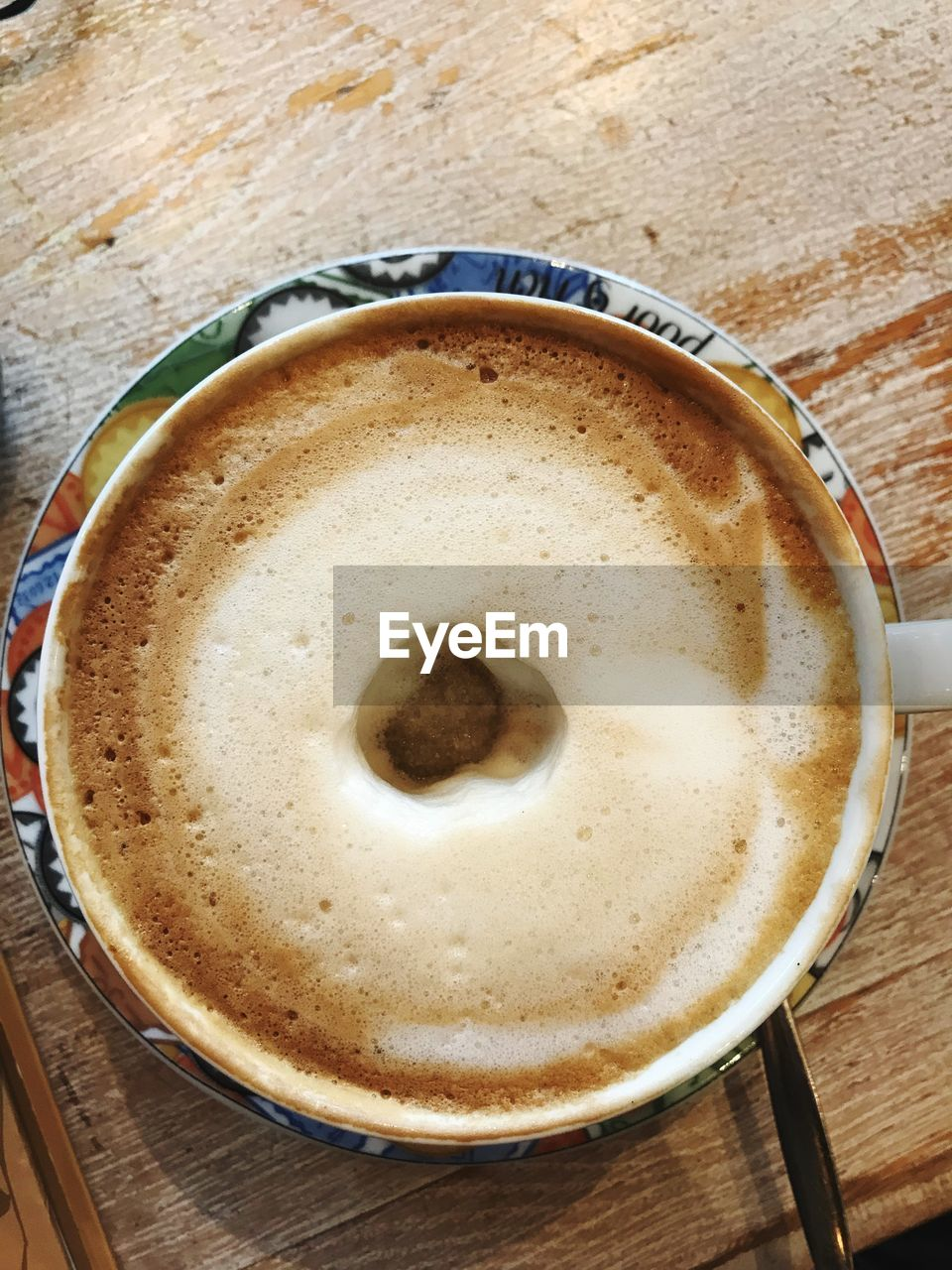 coffee - drink, drink, coffee cup, food and drink, table, frothy drink, refreshment, high angle view, indoors, freshness, froth, cappuccino, no people, close-up, latte, froth art, directly above, healthy eating, day