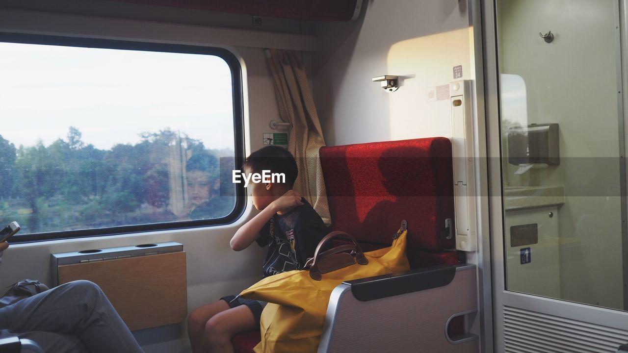 GIRL SITTING IN BUS