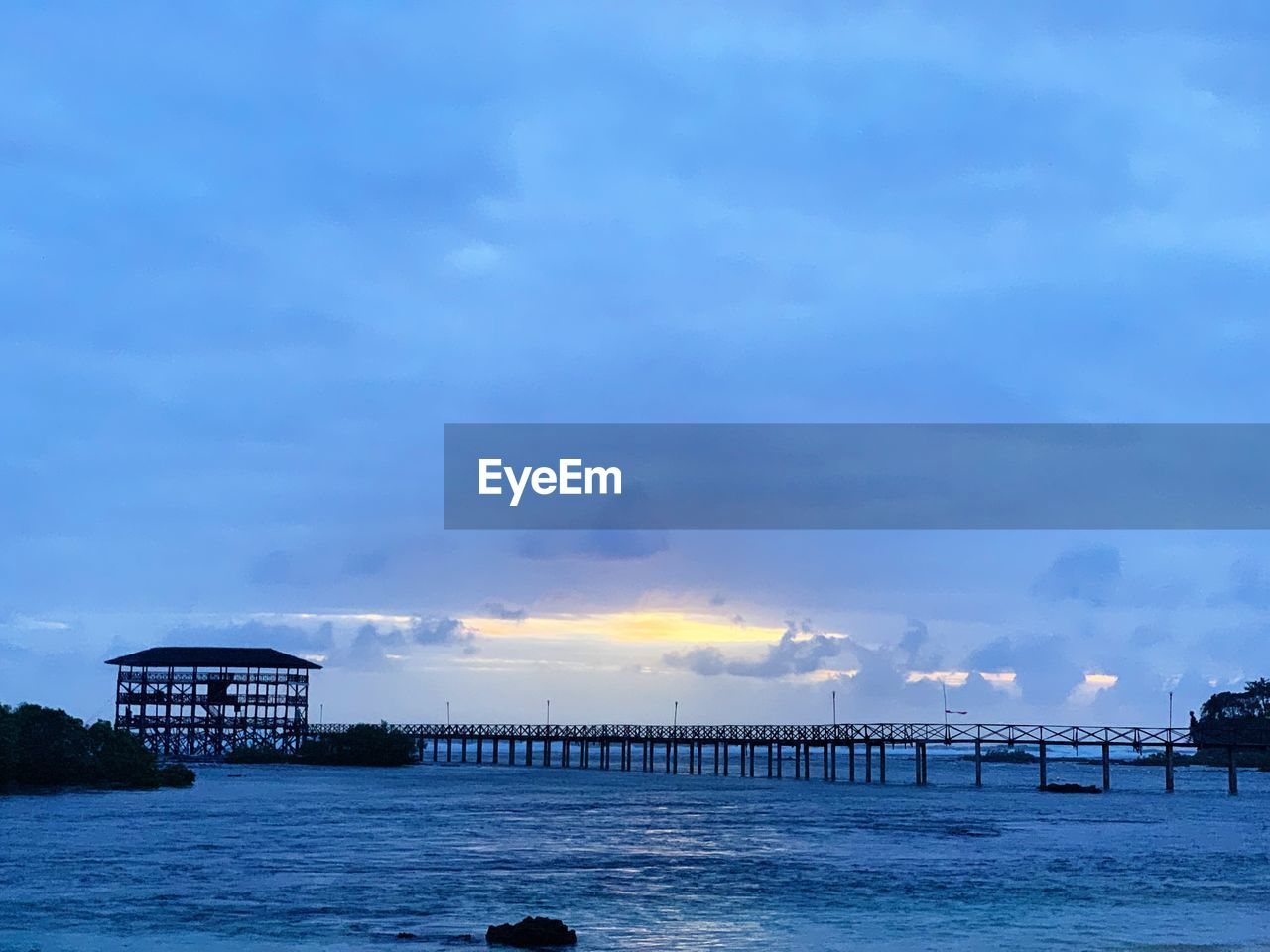 water, sky, cloud - sky, sea, architecture, built structure, pier, nature, beauty in nature, building exterior, scenics - nature, no people, sunset, waterfront, beach, outdoors, land, tranquil scene, dusk