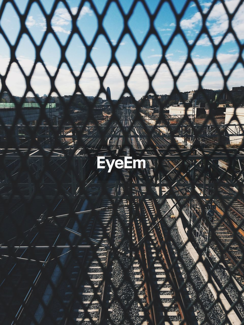 Full Frame Shot Of Railroad Track Seen Through Chainlink Fence