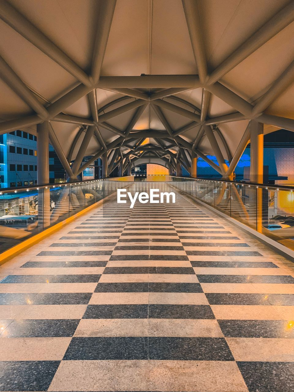 architecture, the way forward, built structure, transportation, direction, indoors, diminishing perspective, pattern, ceiling, empty, symbol, road marking, no people, bridge, connection, bridge - man made structure, absence, sign, checked pattern, vanishing point, flooring, architectural column, tiled floor