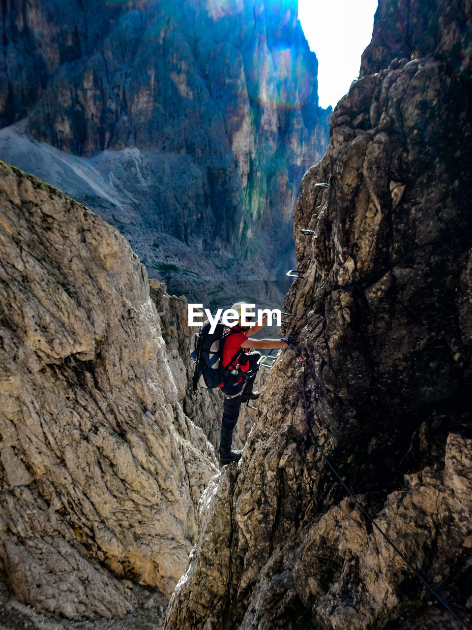 Side View Of Mature Man Climbing Mountain