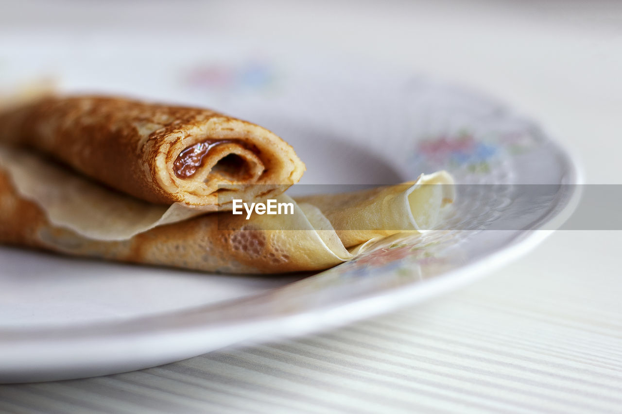 food, food and drink, plate, close-up, still life, table, freshness, selective focus, ready-to-eat, indoors, no people, serving size, snack, bread, indulgence, baked, healthy eating, sweet food, focus on foreground, paper, temptation, breakfast