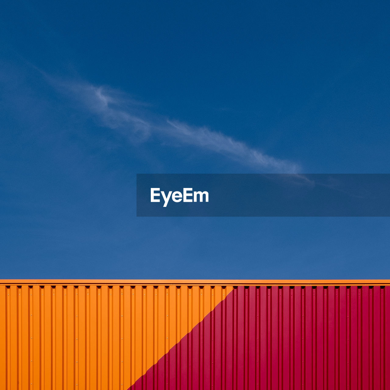 Low angle view of cargo container against blue sky