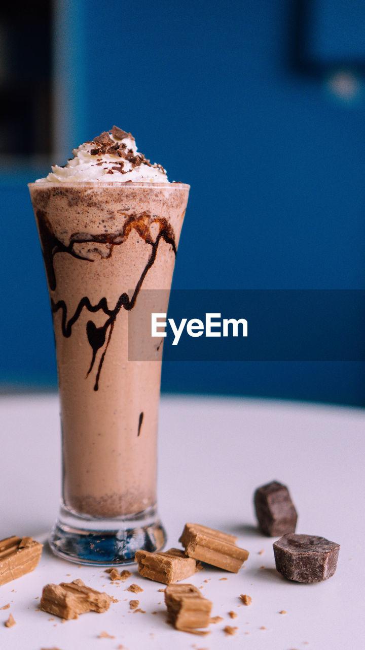 Close-up of milkshake on table