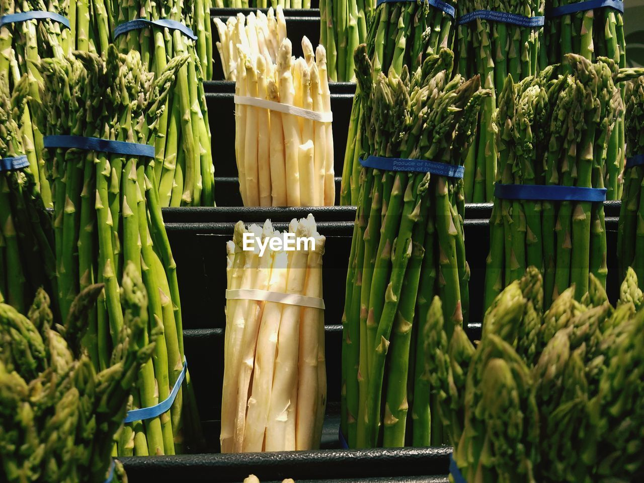 Bunch of asparagus for sale at market stall