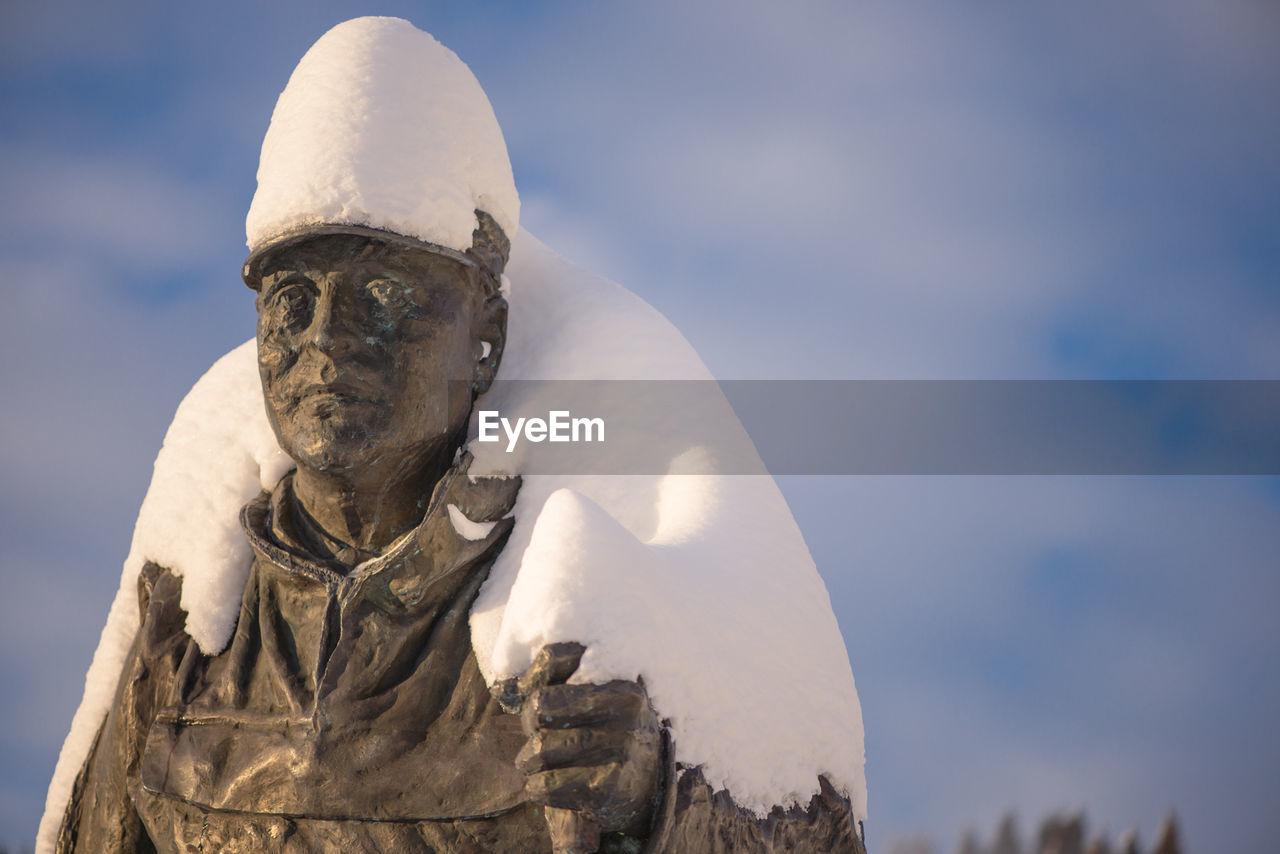 Statue with snow against sky at holmenkollbakken