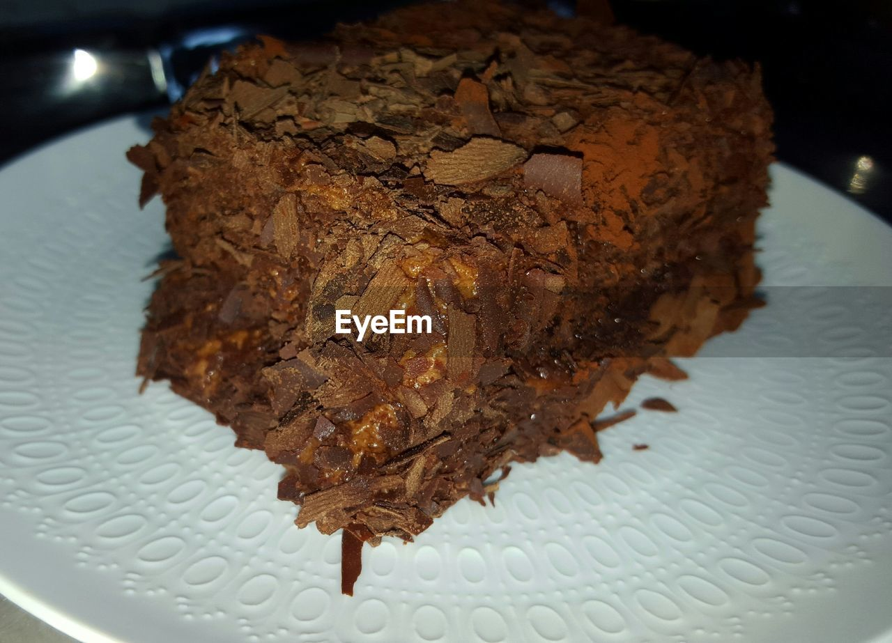 Close-up of chocolate mousse cake served on table