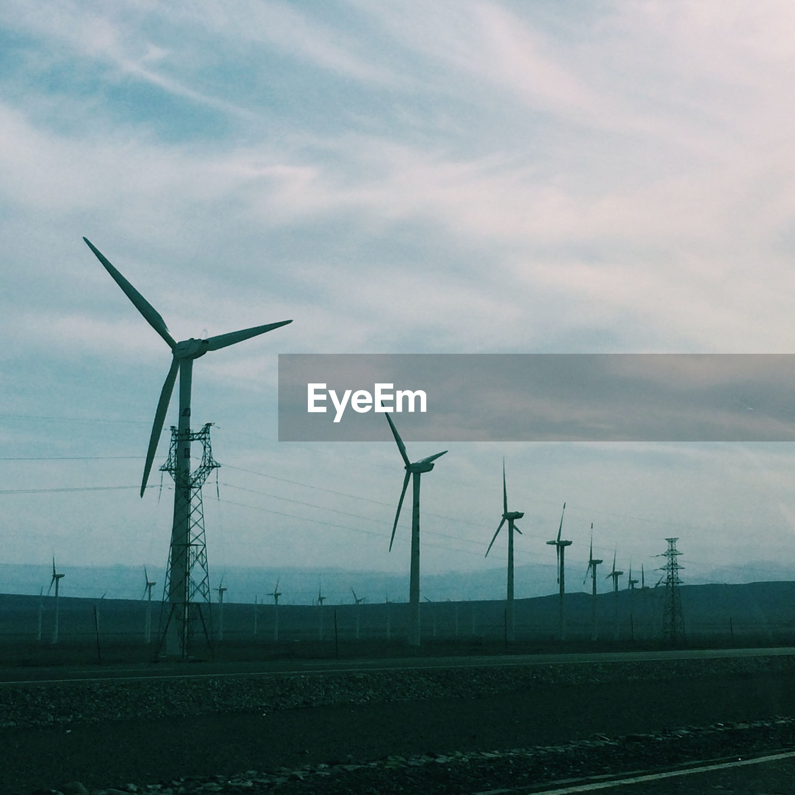 wind turbine, fuel and power generation, wind power, alternative energy, environmental conservation, renewable energy, windmill, field, sky, landscape, rural scene, technology, electricity pylon, cloud - sky, agriculture, traditional windmill, electricity, power supply, nature, day