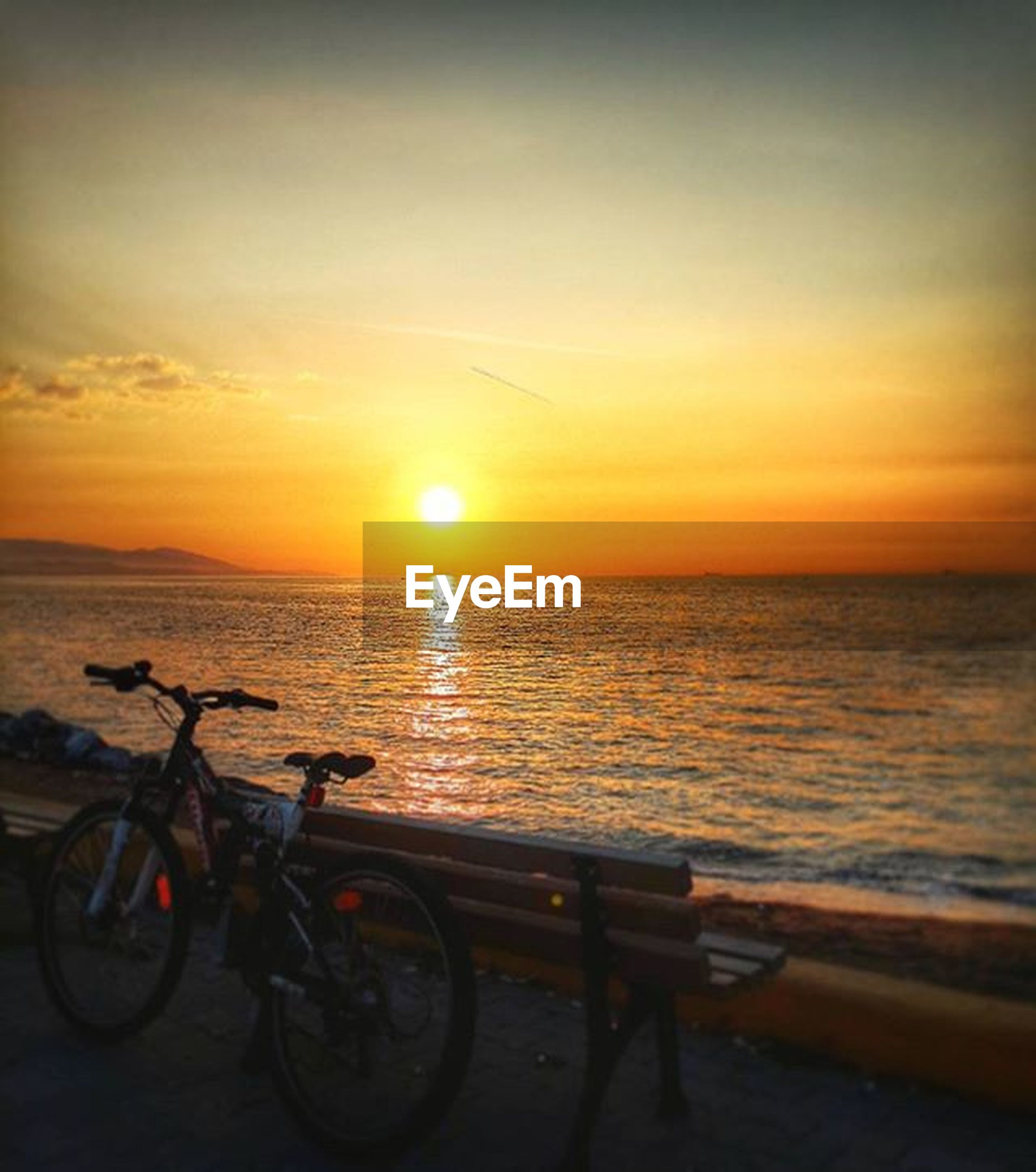 sunset, sea, horizon over water, water, sun, orange color, transportation, scenics, beauty in nature, mode of transport, bicycle, tranquility, tranquil scene, beach, sky, nature, idyllic, silhouette, shore, land vehicle