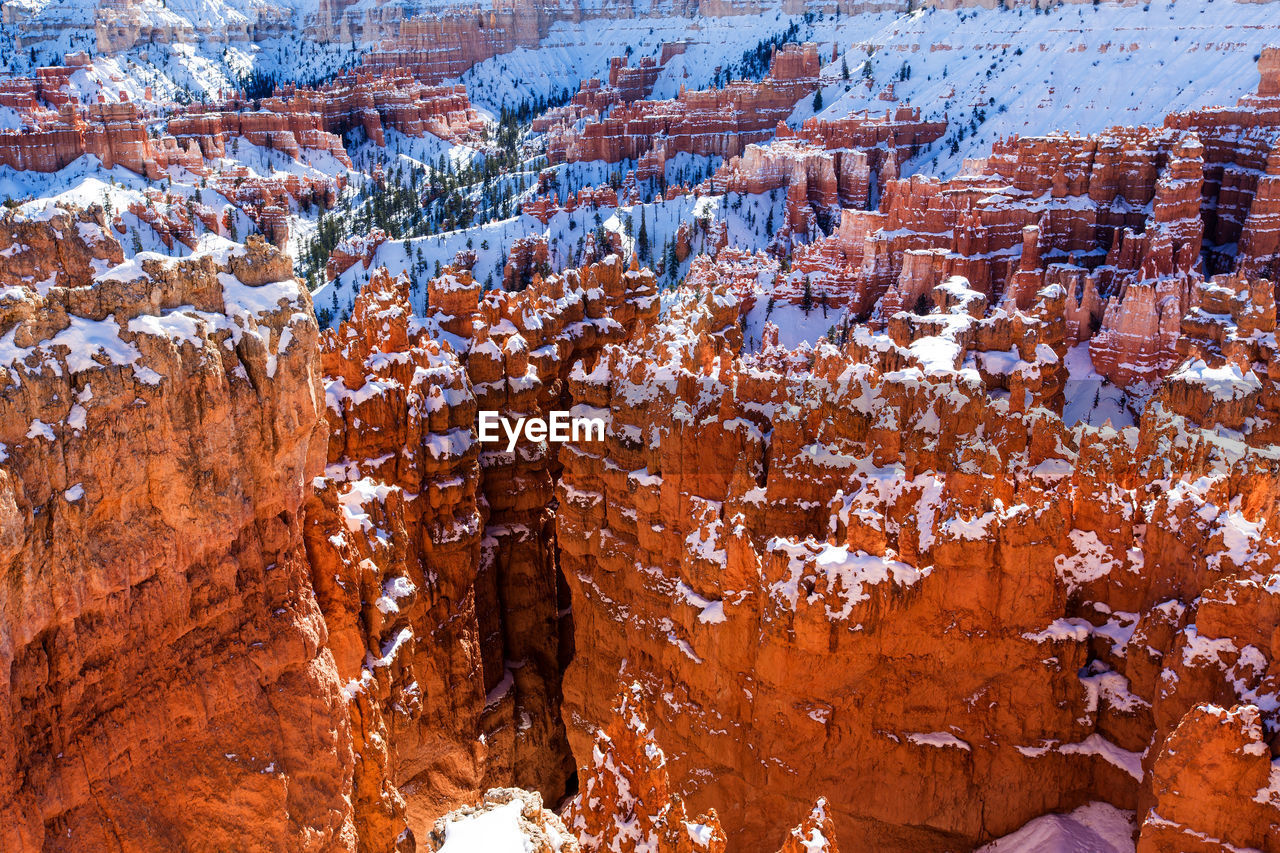 snow, winter, cold temperature, non-urban scene, beauty in nature, nature, no people, rock formation, geology, environment, day, tranquility, rock, tranquil scene, rock - object, travel destinations, solid, physical geography, scenics - nature, outdoors, eroded