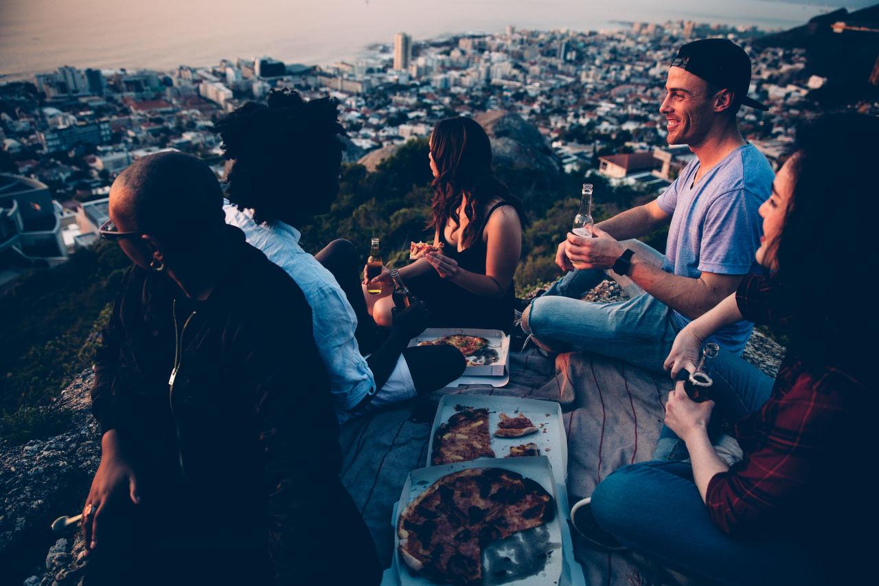 People having picnic at sunset