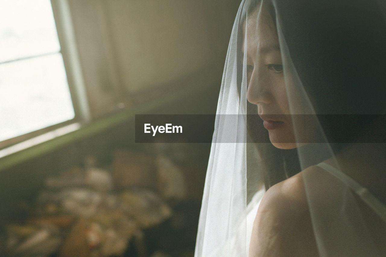 Close-Up Of Bride Wearing Wedding Dress
