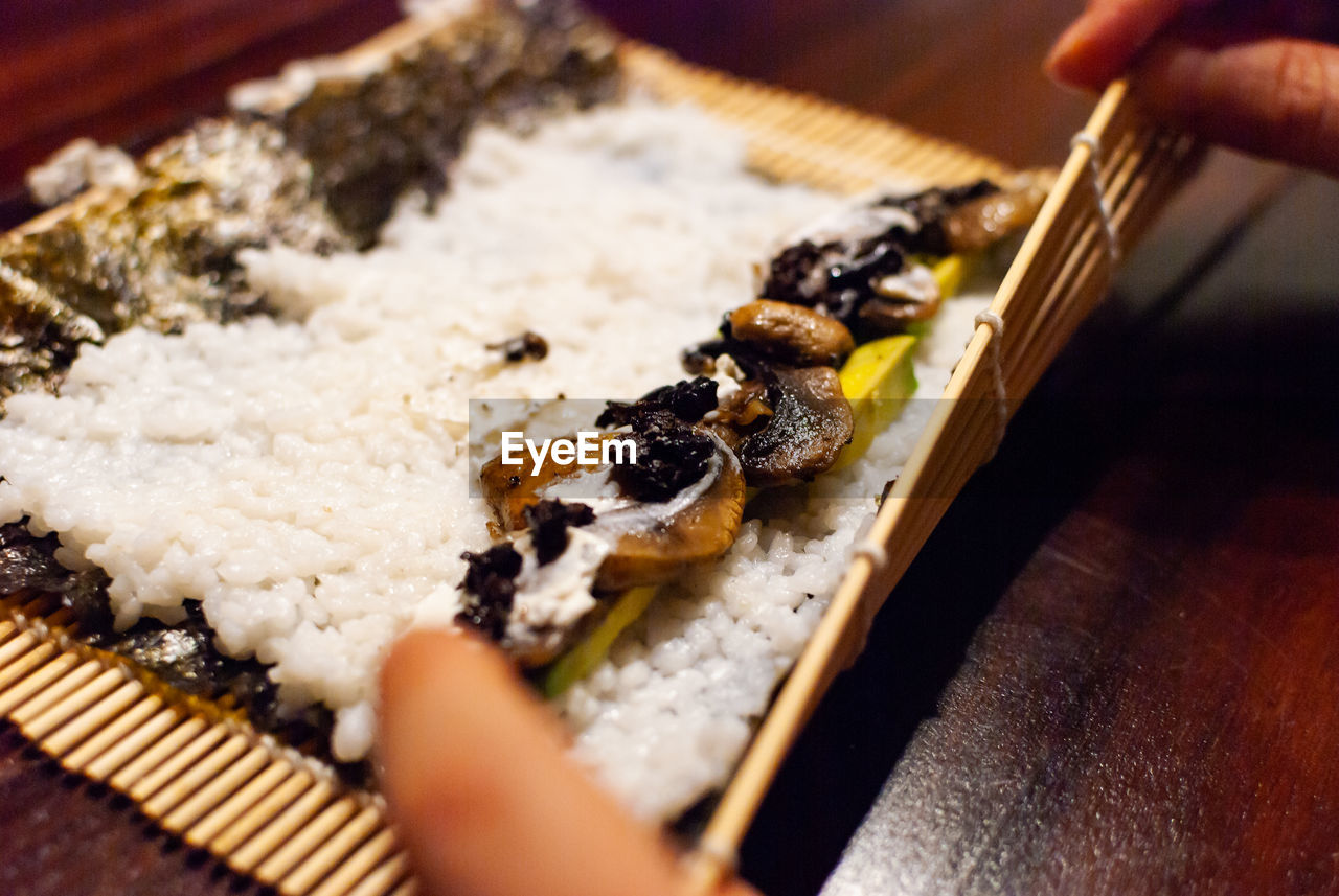 human hand, hand, food, food and drink, human body part, selective focus, one person, unrecognizable person, real people, indoors, finger, freshness, human finger, holding, lifestyles, body part, preparation, close-up, preparing food, japanese food