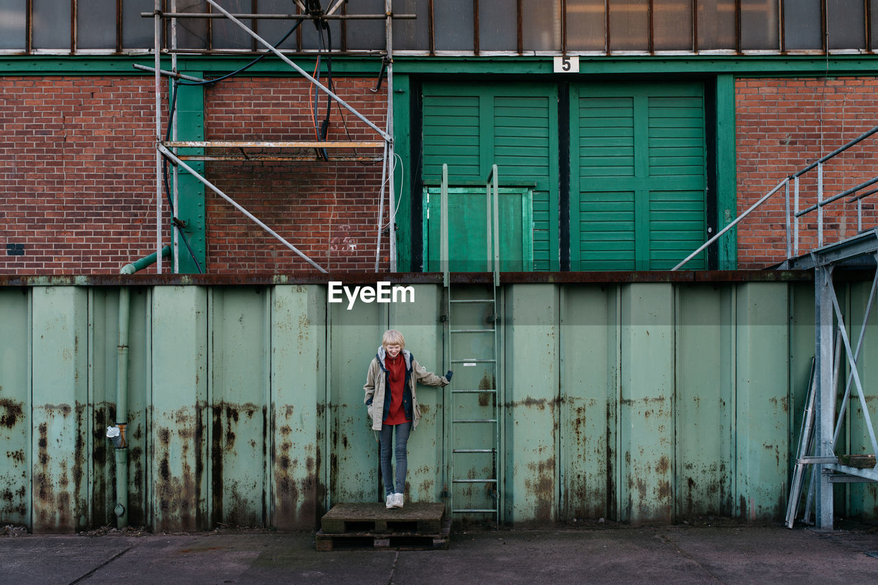 Woman standing outside of building