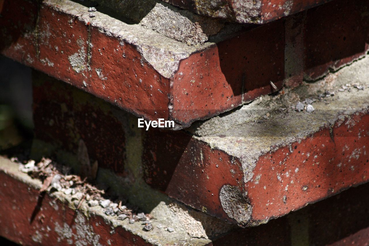 brick, close-up, brick wall, no people, wall, day, focus on foreground, textured, outdoors, wall - building feature, built structure, architecture, weathered, selective focus, metal, red, nature, rusty, pattern, abandoned, concrete