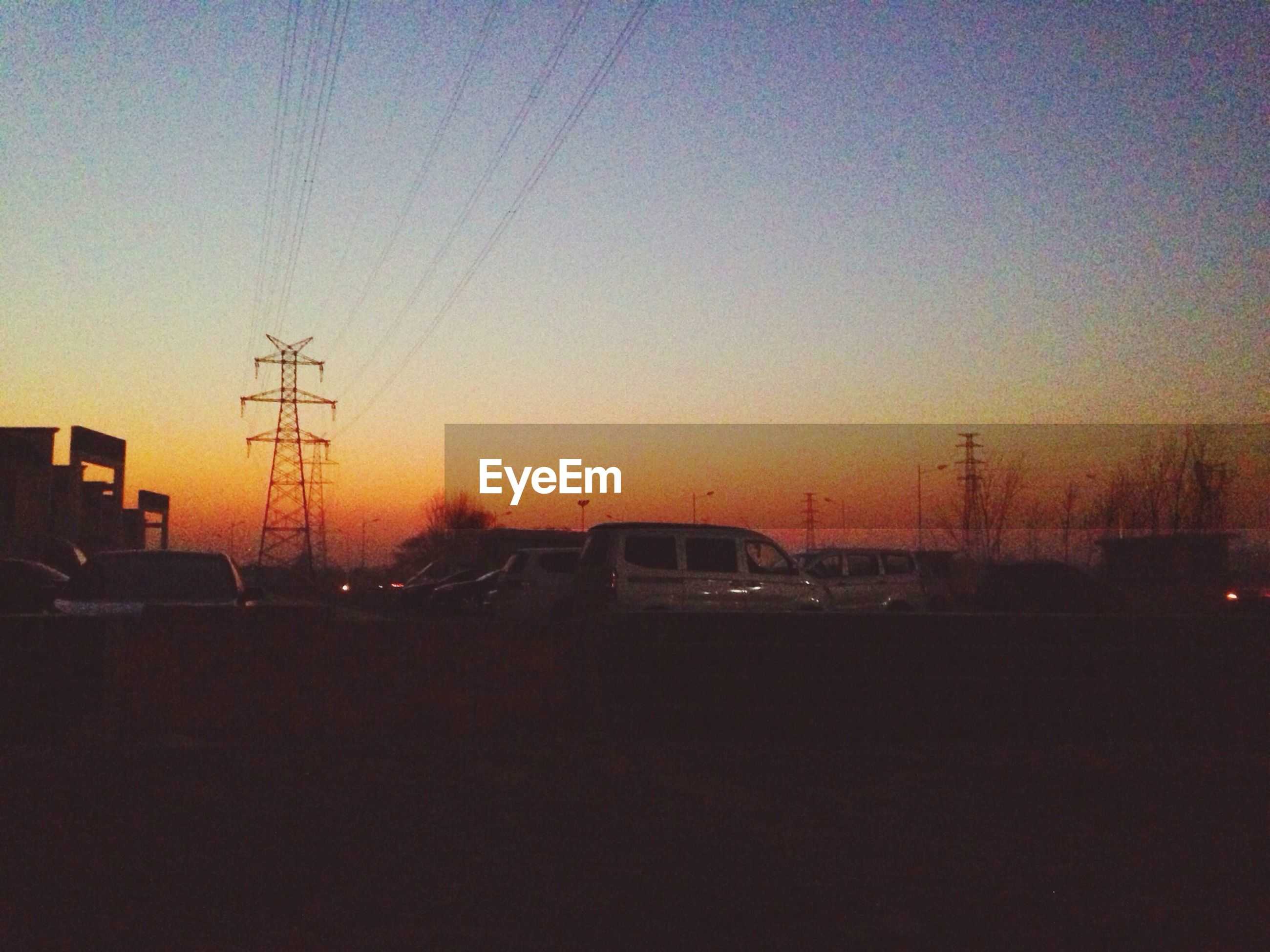 sunset, electricity pylon, power line, silhouette, transportation, clear sky, electricity, copy space, power supply, orange color, car, connection, cable, mode of transport, dusk, land vehicle, sky, street light, fuel and power generation, road