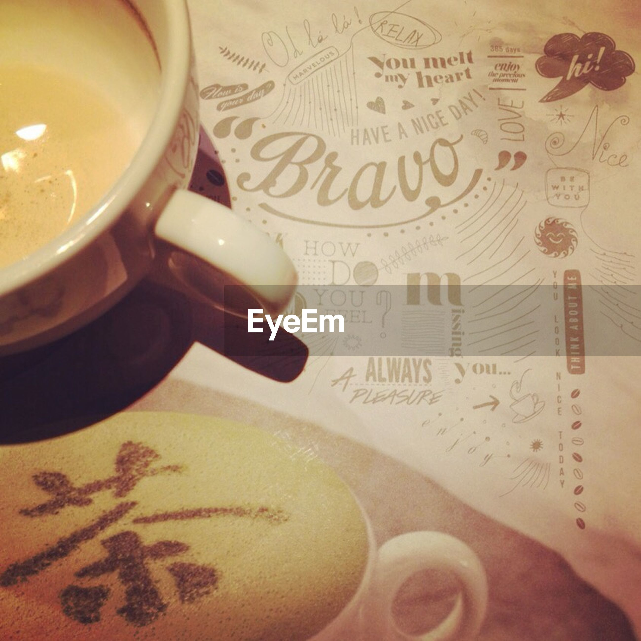 indoors, food and drink, text, table, drink, western script, freshness, coffee cup, communication, refreshment, still life, close-up, book, paper, coffee - drink, cup, coffee, food, high angle view, cropped