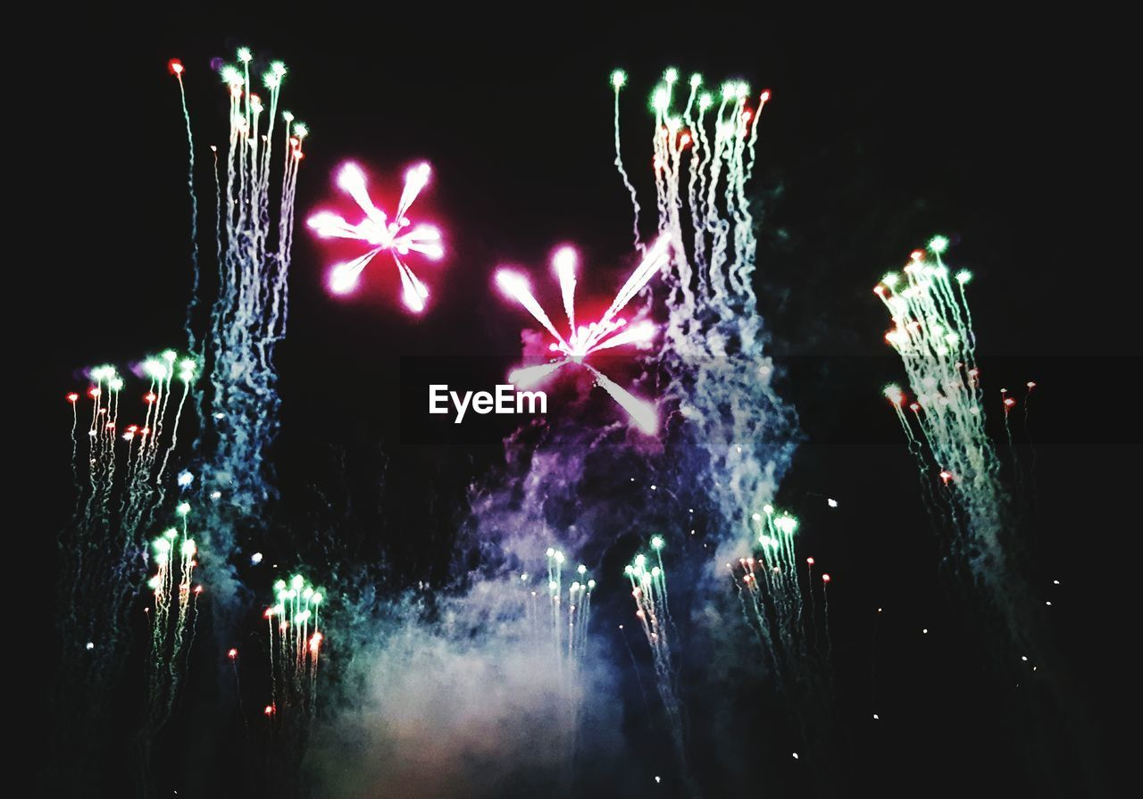 night, celebration, firework display, illuminated, firework - man made object, exploding, arts culture and entertainment, long exposure, glowing, event, firework, motion, blurred motion, multi colored, outdoors, no people, low angle view, sparkler, sky