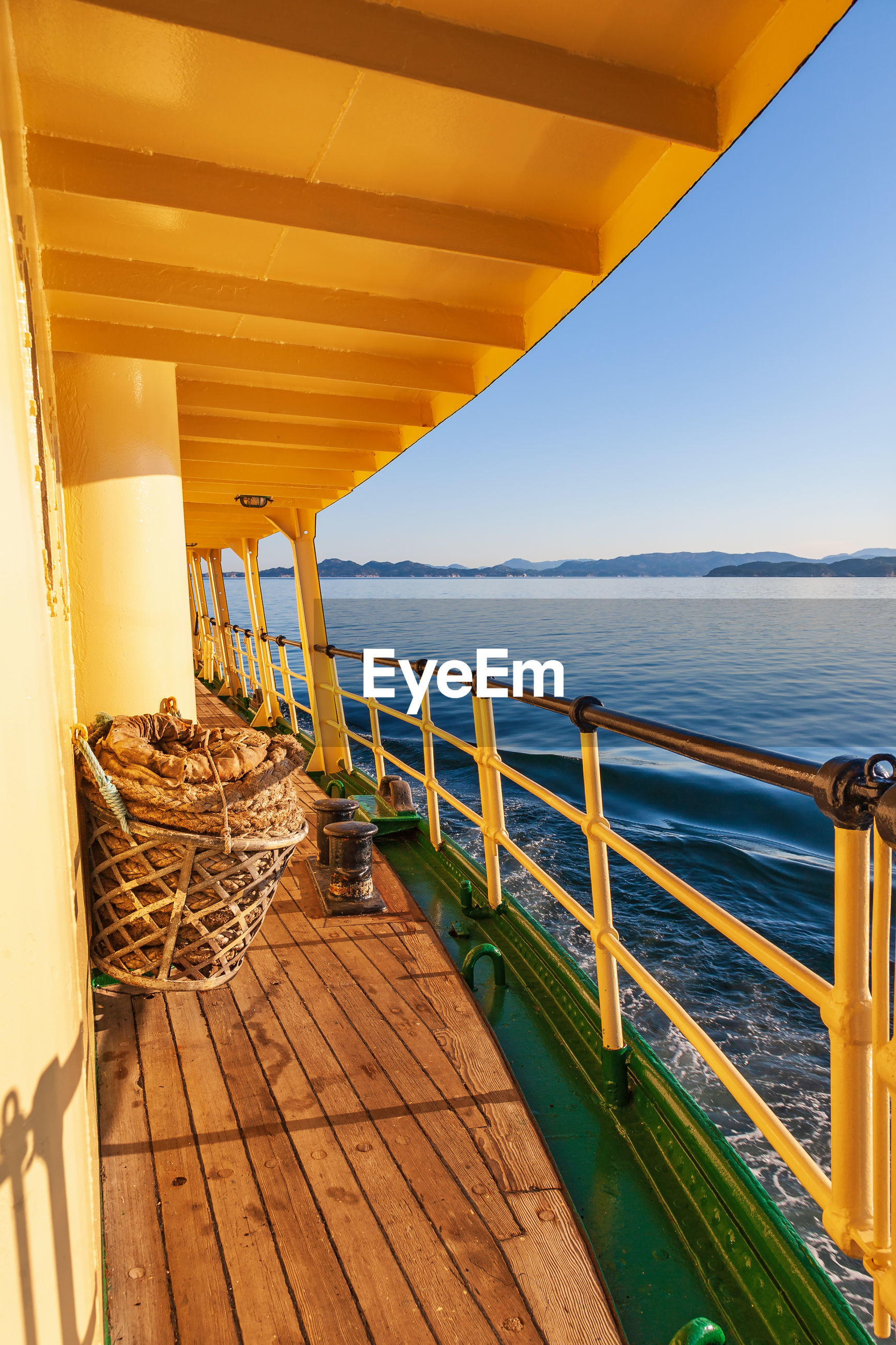SCENIC VIEW OF SEA AGAINST SKY SEEN FROM WOODEN PIER