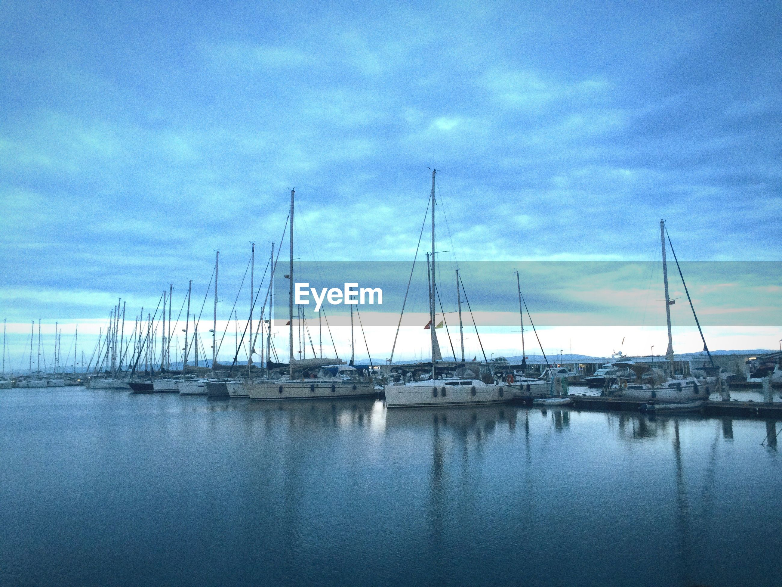 nautical vessel, water, transportation, boat, moored, mode of transport, sky, sea, reflection, mast, waterfront, sailboat, tranquility, harbor, tranquil scene, cloud - sky, cloud, nature, scenics, beauty in nature
